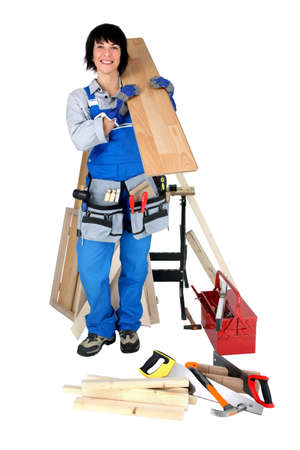 Tradeswoman posing with her tools and building supplies Stock Photo - 16037721