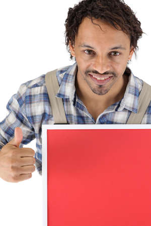 Tradesman holding a red sign and giving the thumb Stock Photo - 16037512