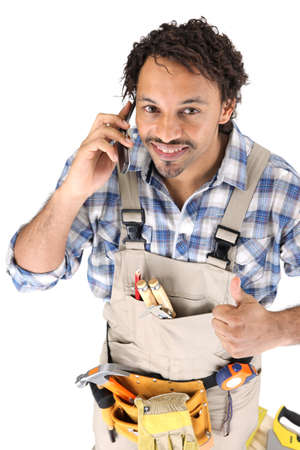 Carpenter receiving good news over the phone Stock Photo - 16037558