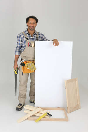 Furniture maker stood by blank panel photo
