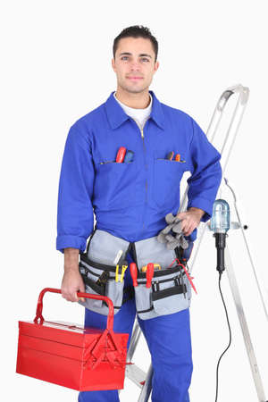 Skillful electrician with equipment on white background photo