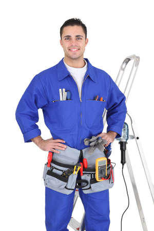 boiler suit: Full-length portrait of a handyman with his tools