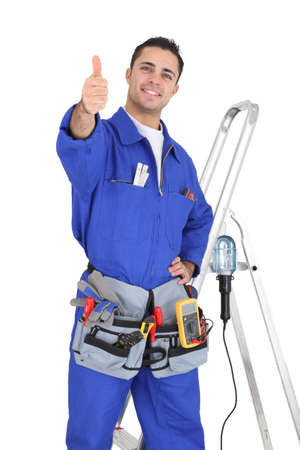 qualified worker: Handyman stood by equipment giving the thumbs-up