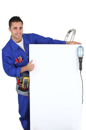 jumpsuite: electrician showing a panel Stock Photo