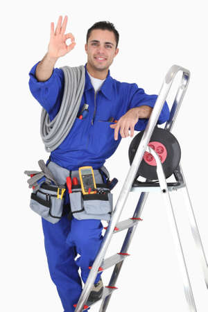 electrician tools: Tradesman giving the a-ok sign Stock Photo