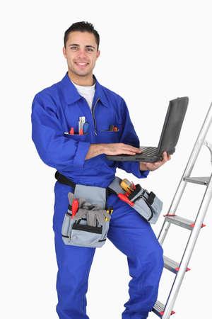 Tradesman posing with his tools Stock Photo
