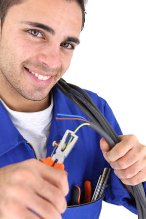 disconnecting: electrician using pliers Stock Photo