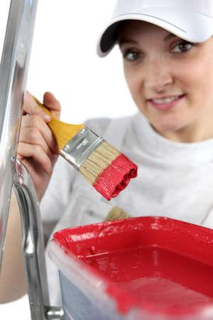 craftswoman: craftswoman painter working