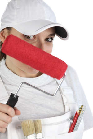 self sufficient: Female decorator with a red roller