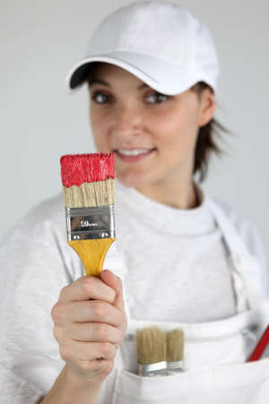 Painter with a paintbrush in her hand photo