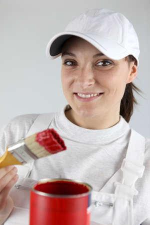 Decorator with a pot of red paint photo
