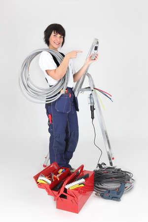 joiner: Woman electrician on white background