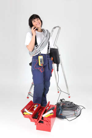 business tool: woman electrician with tools Stock Photo