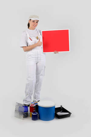 woman painter holding red panel for message photo