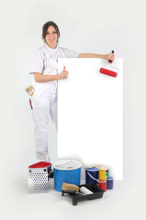 Painter posing with her supplies next to a blank sign Stock Photo - 16037829