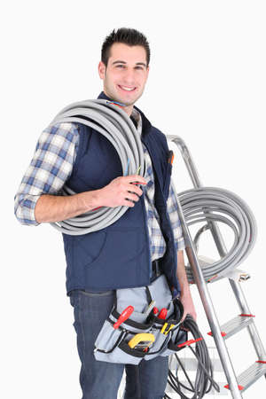 cabling: Electrician on cabling job Stock Photo
