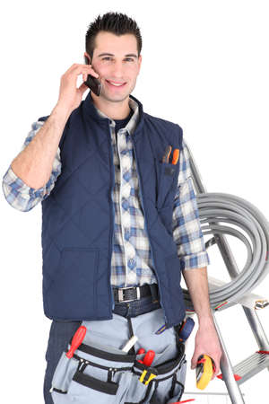 Electrician making call to supplier Stock Photo - 16037591