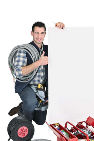 craftsman holding an ad board photo