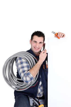 Electrician with blank panel photo