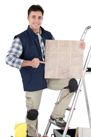 Tradesman pointing to a tile Stock Photo - 16037826