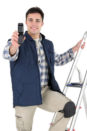 tiler holding a cell phone photo