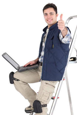 blue collar: Tradesman posing with his tools and laptop