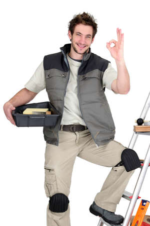 Approving tile fitter posing with his tools and building materials Stock Photo - 16037846