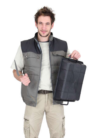 Tile fitter posing with his building supplies Stock Photo - 16037864