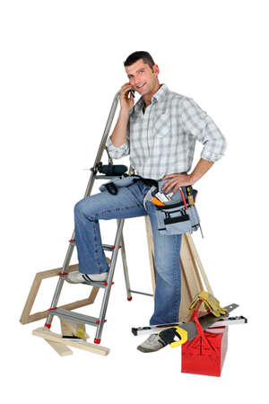Carpenter stood by equipment making call Stock Photo - 16037680