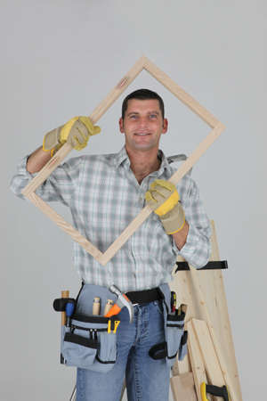 woodworker: woodworker holding a window frame
