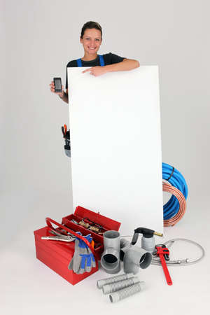 Woman with blank board, toolbox and cellphone photo
