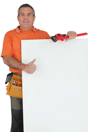 wage earner: Plumber holding message board Stock Photo