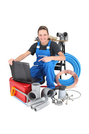 Female plumber with equipment, studio shot photo