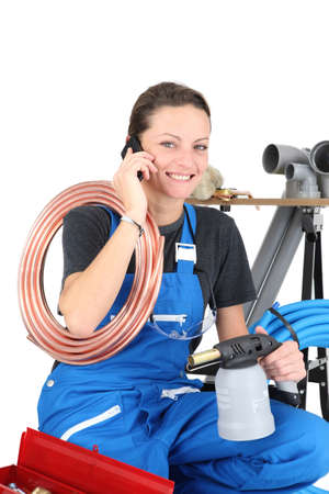 Female plumber and equipment photo
