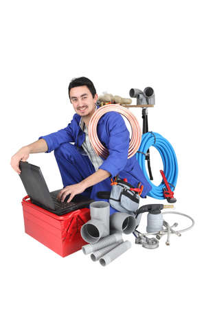 pvc: plumber preparing his equipment and his laptop Stock Photo