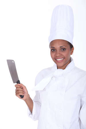 Chef holding meat cleaver photo