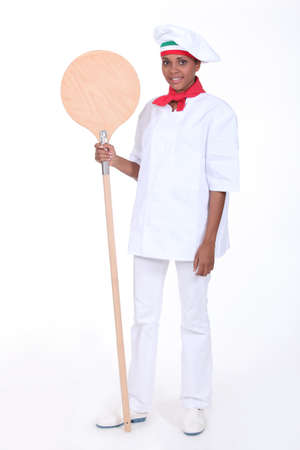 pizza maker: Pizza maker holding a pizza peel