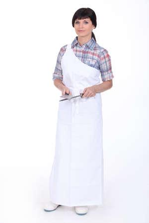 sharpening: Female butcher Stock Photo