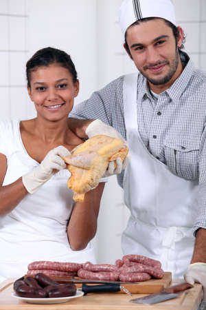 traceability: a butcher and his wife assistant