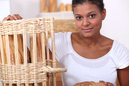 straight faced: Baker posing with her bread