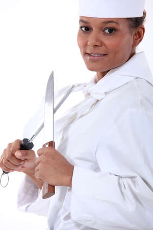 hone: chef sharpening a knife