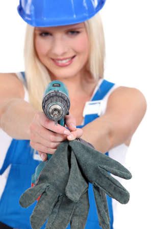 workwoman: Tradeswoman aiming a screwdriver