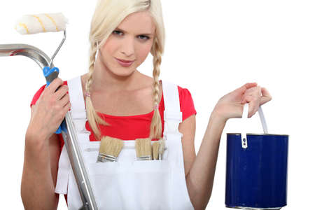 dungarees: Woman in dungarees preparing to decorate Stock Photo