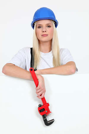 female construction worker: Beautiful female laborer in dungarees