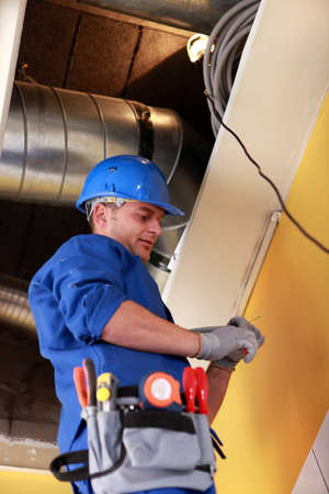 qualified worker: electrical, heating, engineer Stock Photo