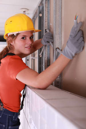 Electrician installing an electrical supply system photo