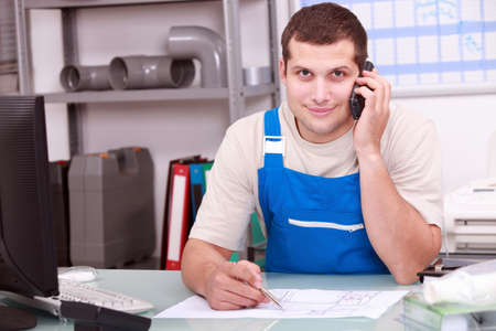 merchant: Plumbers merchant on the telephone