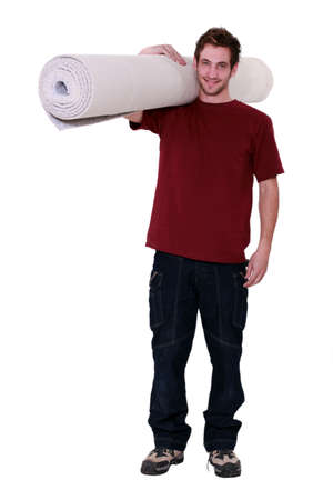 man carrying: Need a new carpet  Stock Photo