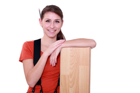 Female carpenter with laminate flooring photo
