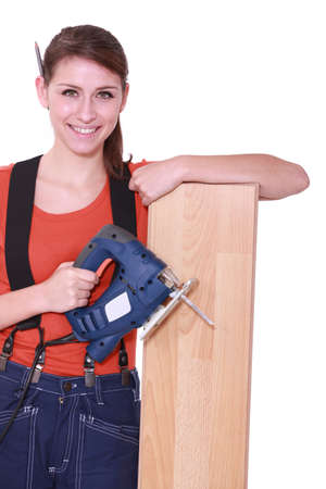 Woman laying wood flooring photo